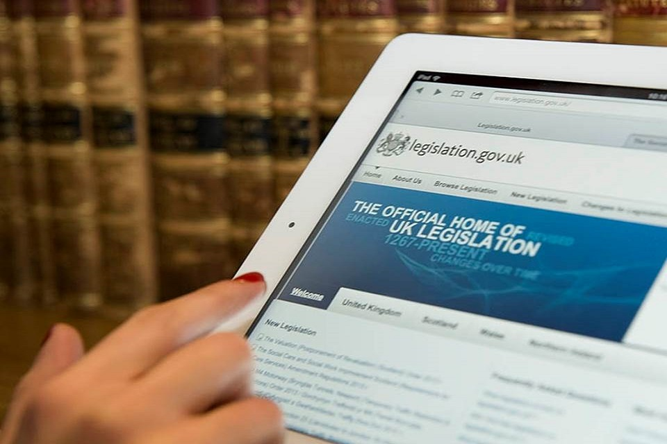 Person browsing legislation.gov.uk on a tablet device.
