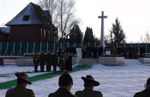 The coffin is lowered into the ground whilst prayers are read during the service for the first reburial at Fromelles on 30 January 2010