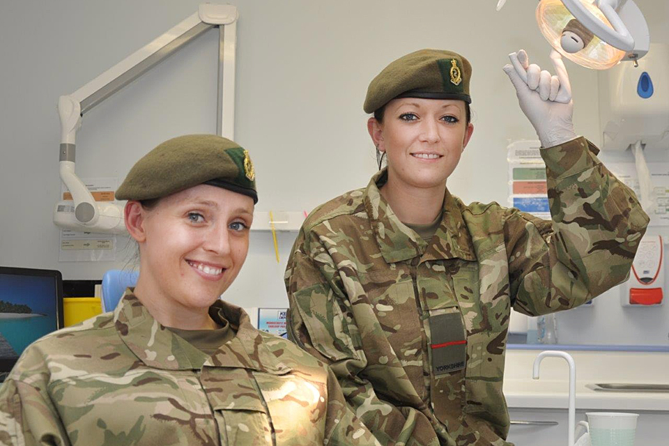 Two dental nurses wearing their military uniforms to work