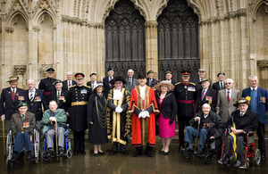 The 18 Kohima veterans on the steps of York Minster with senior military officials and (centre) the Deputy Lord Mayor of York, Councillor John Galvin, and the Lord Mayor of York, Councillor David Horton