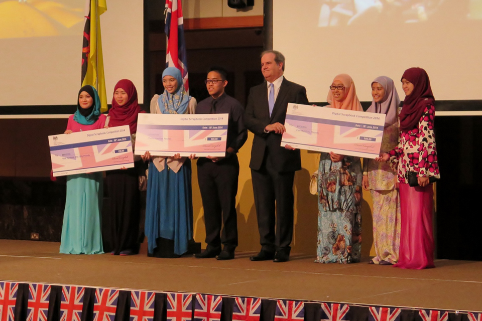 British High Commissioner with the first, second and third place winners of the Digital Scrapbook Competition 2014