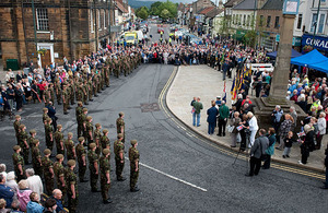Soldiers of 2nd Battalion The Yorkshire Regiment halt for a short ceremony in Guisborough's market place, attended by the mayor, civic dignitaries and onlookers