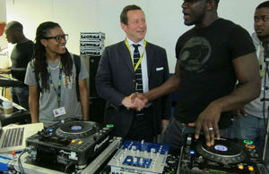 Ed Vaizey meeting young people next to music mixing equipment