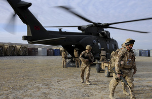 British troops disembark a Merlin helicopter