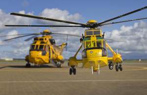Corgi's 1:72 scale die-cast metal Westland Sea King HAR3 RAF Search and Rescue helicopter alongside the real thing (images manipulated)