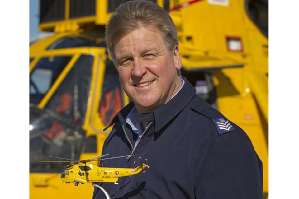Flight Sergeant Andy Carnall, designer of the RAF Search and Rescue Force's 70th anniversary aircraft decal, with one of the Corgi model helicopters