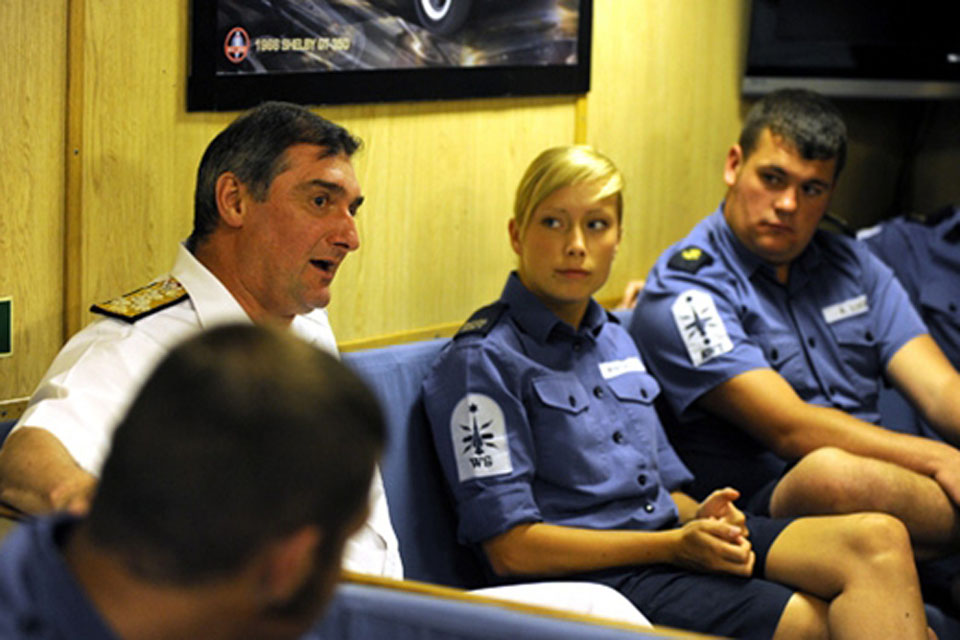 Admiral Soar chats with some of HMS Cornwall's junior rates in one of the frigate's messes