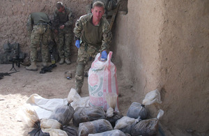 Sergeant Terry Johnson with carefully bagged evidence that may help to identify the owners of the explosives and their intended use