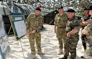 Brigadier Paul Nanson (left), Commander 7 Armoured Brigade, briefs General Sir Peter Wall, Chief of the General Staff (2nd left), and General Elrick Irastorza, Chef d'Etat Major de l'Armée de Terre (3rd left), on Exercise Flandres