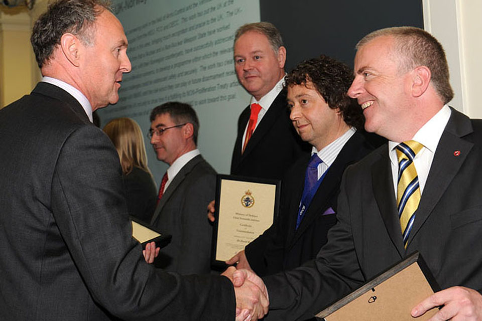 Professor Mark Welland, the Chief Scientific Adviser (left), meets Defence scientists at the London awards ceremony of the CSA Commendation Scheme