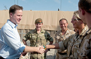 Deputy Prime Minister Nick Clegg congratulates Catherine Graham on her promotion to Lance Corporal