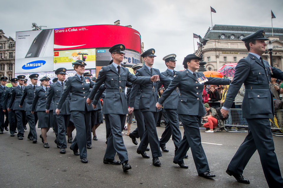 Royal Air Force personnel marching through Piccadilly Circus in London