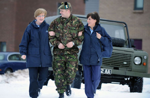 Corporal Joe Mearns gives a helping hand to Community Staff Nurses Margaret McLoskey (right) and Rosemary Robertson