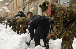 Military personnel, including members of The Royal Regiment of Scotland, helping to clear snow to allow access to Edinburgh's 'Sick Kids' Hospital