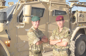 Marine James Hoyes, of 40 Commando Royal Marines, with his father Captain Christopher Wilcock, of 23 Engineer Regiment (Air Assault)