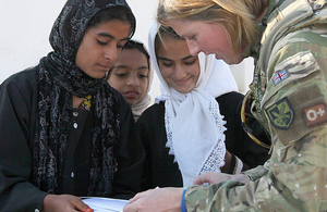 A service woman visiting a school in Gereshk, Helmand province (library image) [Picture: Petty Officer Airman (Photographer) Sean Clee, Crown copyright]