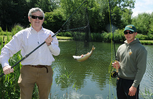 Sapper Will Coldrick from 26 Engineer Regiment (right) with Instructor Jim Steele shows off a fine 1.4kg Rainbow Trout caught during the inaugural Fishing 4 Forces day at Avon Springs Fisheries, Durrington