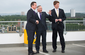 David Cameron, Danny Alexander and Gordon Matheson look out over the Glasgow skyline.
