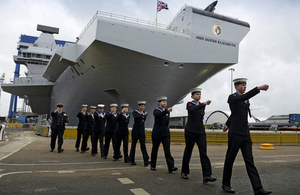 Sailors march past HMS Queen Elizabeth at the naming ceremony [Picture: Chief Petty Officer Airman (Photographer) Tam McDonald, Crown copyright]