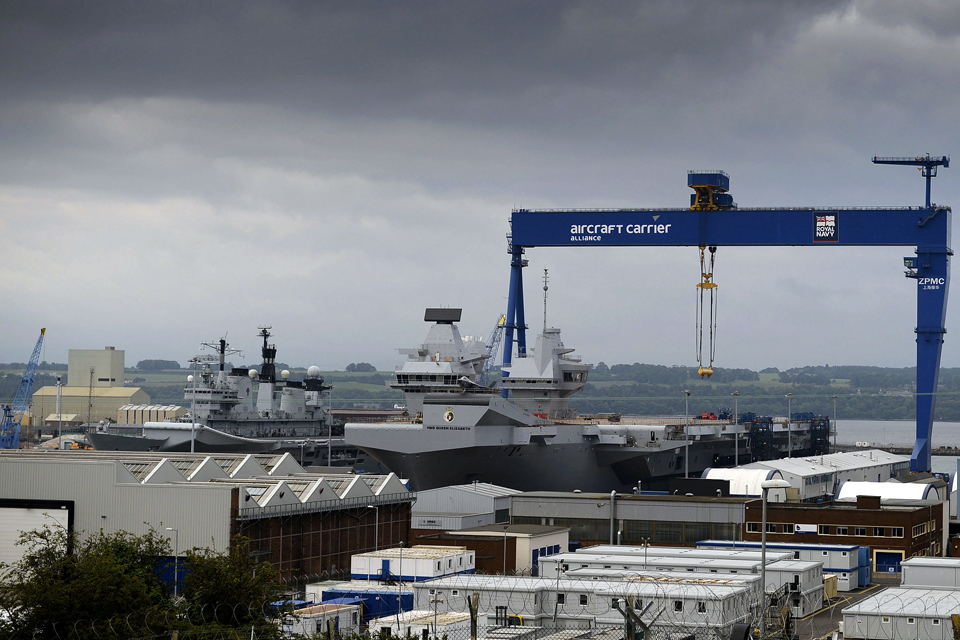 HMS Illustrious alongside the new carrier