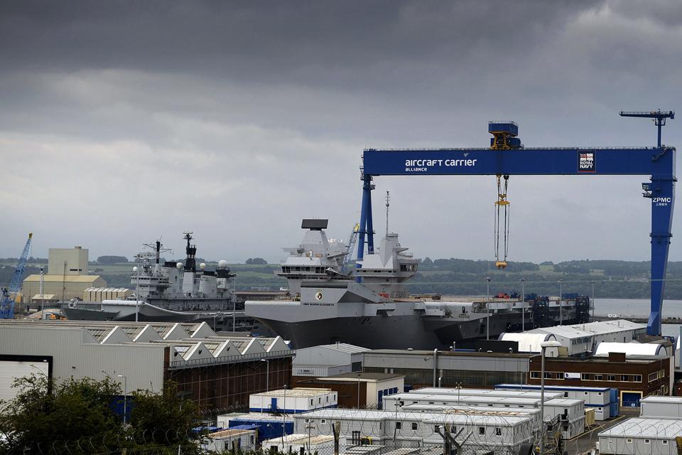 HMS Illustrious alongside the new carrier