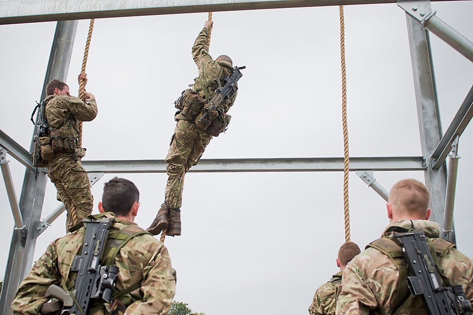 Royal Marines reservists climb a training frame