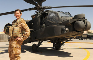 Army Air Corps Pilot Captain Joanna Gordon in front of an Apache attack helicopter