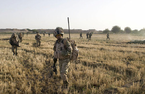 Gurkhas from C Company, 1st Battalion The Royal Gurkha Rifles, and soldiers from the Afghan National Army cross a recently harvested field during a joint patrol in the Nahr-e Saraj region of Helmand province (stock image)