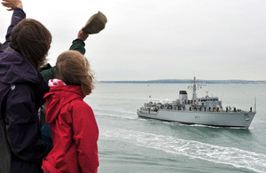 HMS Chiddingfold passes the Round Tower in Portsmouth, from where well-wishers welcome her home
