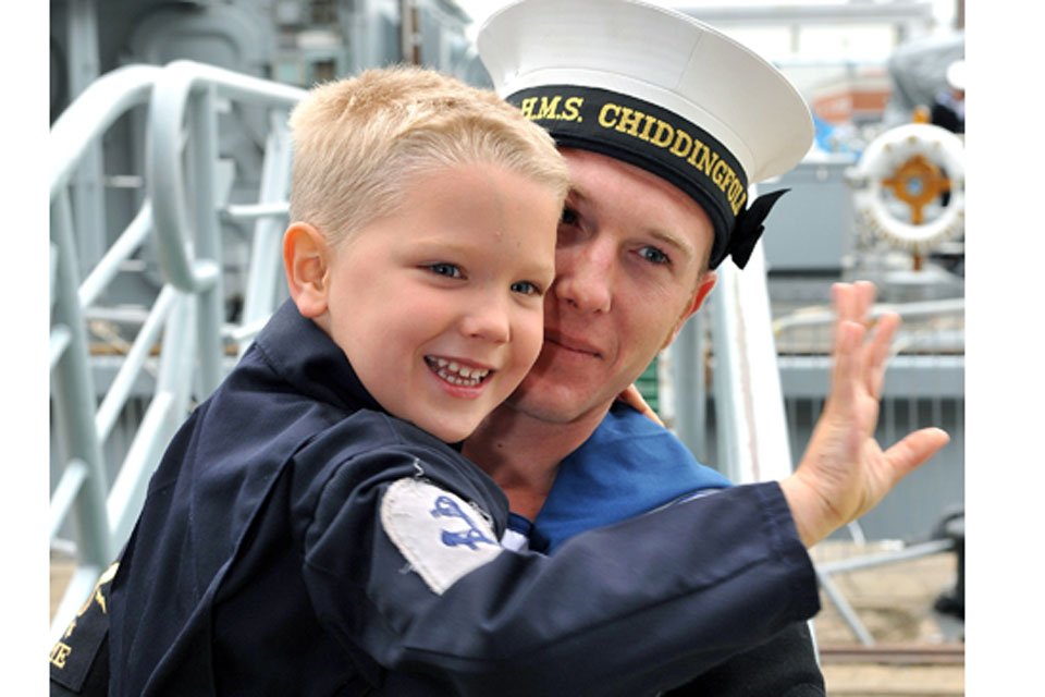 Leading Engineering Technician (Marine Engineer) Lee greets his son Edward