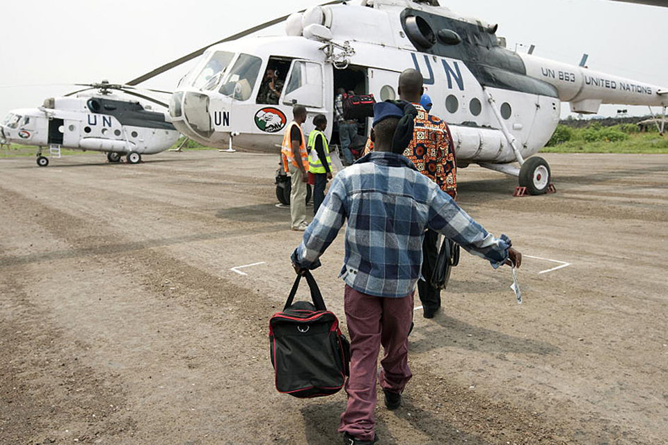 Former child soldiers board a helicopter flight of the United Nations Organisation Mission in the Democratic Republic of the Congo (MONUC) for repatriation to undisclosed regions of the country