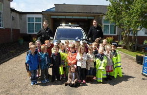 CNC visit to Pennyland Primary School. Pictured in front of a police vehicle.