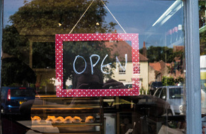 Open sign in the window of a bakery