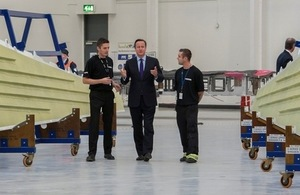 Prime Minister David Cameron visiting Bombardier in Belfast in October 2013.