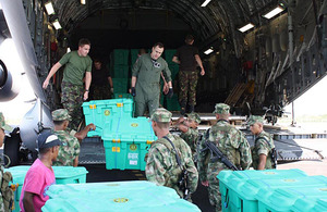 ShelterBoxes are unloaded from a RAF C-17 transport aircraft at Cartagena Airport in Colombia