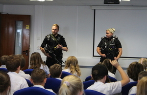School children meet cnc officers in classroom