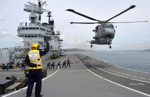 A Merlin Mk2 helicopter hovers above the flight deck of HMS Illustrious (library image) [Picture: Petty Officer Airman (Photographer) Ray Jones, Crown copyright]