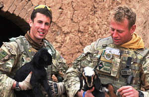 Soldiers from 5th Battalion The Royal Regiment of Scotland holding kids - baby goats - as part of the Veterinary Teaching Initiative near Lashkar Gah in Helmand province