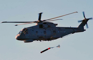 Anti-submarine torpedo is dropped from a helicopter