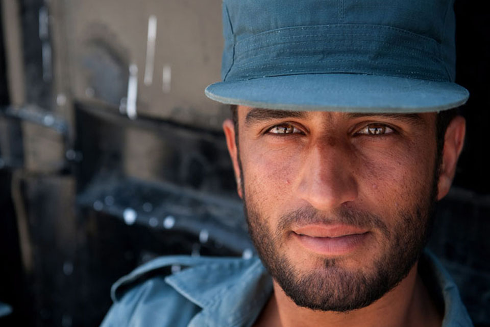 An Afghan policeman on the day of his graduation from the Helmand Police Training Centre in Lashkar Gah