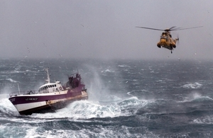Royal Navy Sea King helicopter comes to the aid of a fishing vessel