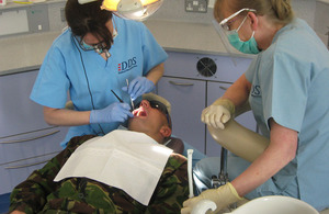 Lieutenant Colonel Jo Loudon and dental nurse Gwen Sanderson work on a 16 Air Assault Bridgade soldier's teeth