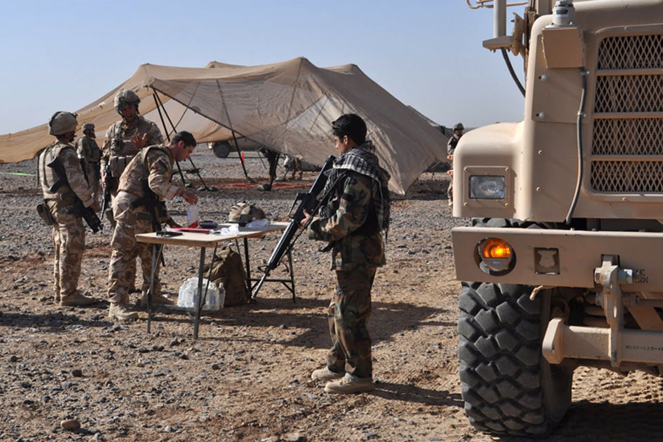 Afghan National Army soldiers and gunners from No 1 Squadron RAF Regiment set up a reception area for a primary health care clinic at the village of Habibabad