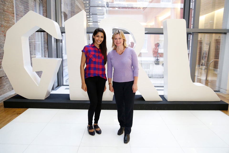 Photo of Justine Greening and Freida Pinto