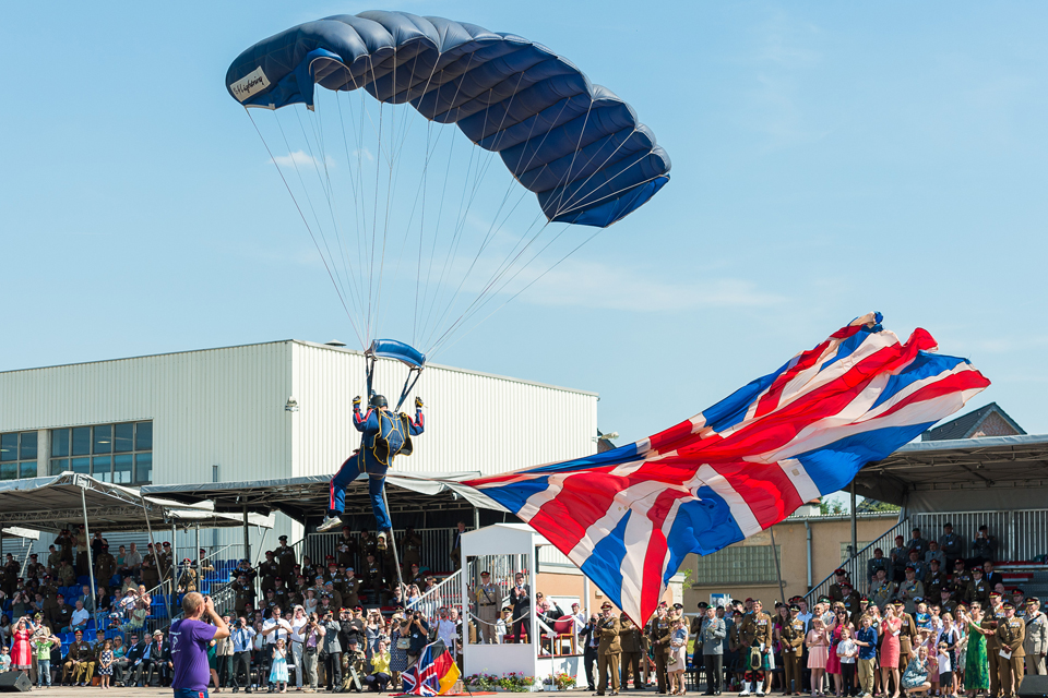 A parachutist flying the Union Flag