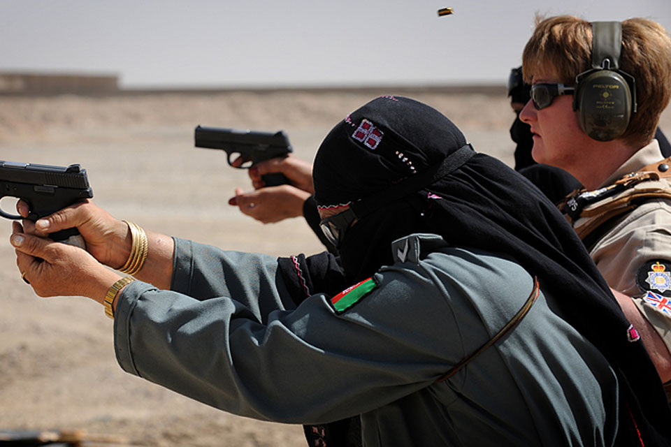 MOD police officer Isabella McManus observes female Afghan police officers on the firing range