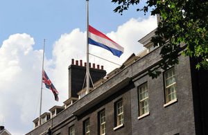 The Union and Dutch flags flying at half-mast over Downing Street