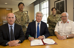 From left: CEO of G4S, Ashley Almanza, Defence Secretary Michael Fallon and General Sir Peter Wall signing the corporate covenant [Picture: Sergeant Pete Mobbs, Crown copyright]