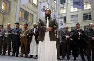 Imam Asim Hafiz leads armed forces Muslims in prayer at the launch of the Armed Forces Muslim Forum [Picture: Sergeant Pete Mobbs, Crown copyright]