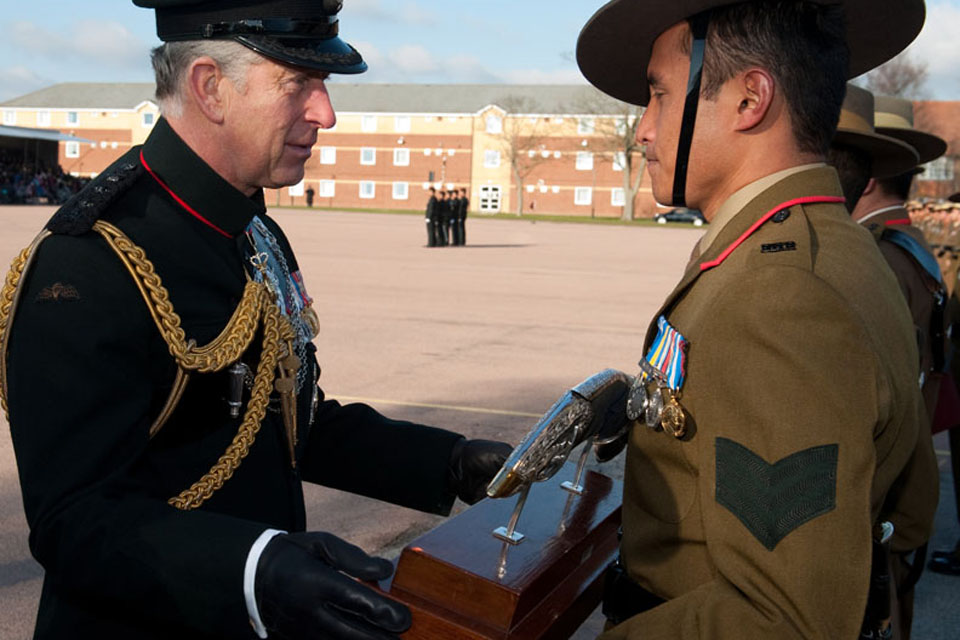 Prince Charles presents Sergeant Bikash Gurung with the Prince of Wales Kukri